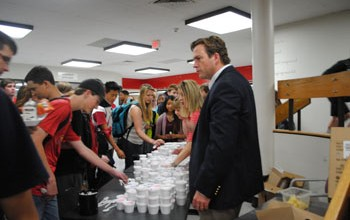 Principal Mr. Tim McCarthy surprises students at both lunches with free ice cream. The administration wanted to show their appreciation of the students&#039; cooperation during EOCs and other testing. Photo by Meaghan Flynn.