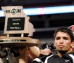 Senior Augie Brooks raises the second-place trophy for the Class 5 State Championship. The team lost 51-14 to Lee's Summit West on Nov. 30 at the Edward Jones Dome. Photos by Emily Schenberg.