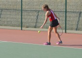 Sophomore Elena Wilner prepares to serve at a match on September 30, 2014.