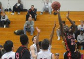 Laying the ball up, senior Jarrett Cox-Bradley scores 2 points in his 37 point performance in a win at Parkway South on Dec. 4.