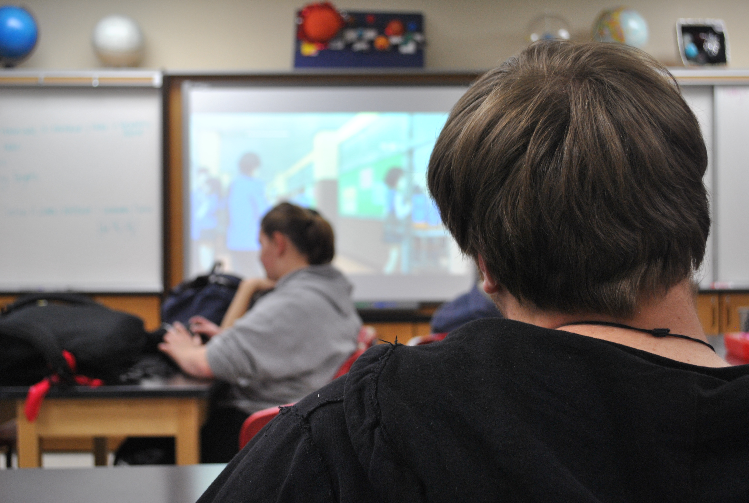 Students view anime after school on Monday, Dec. 1, in Ms. Becky Orth's room. All students are welcome to come to the weekly viewings immediately following the bell. Photo by Danielle Serota