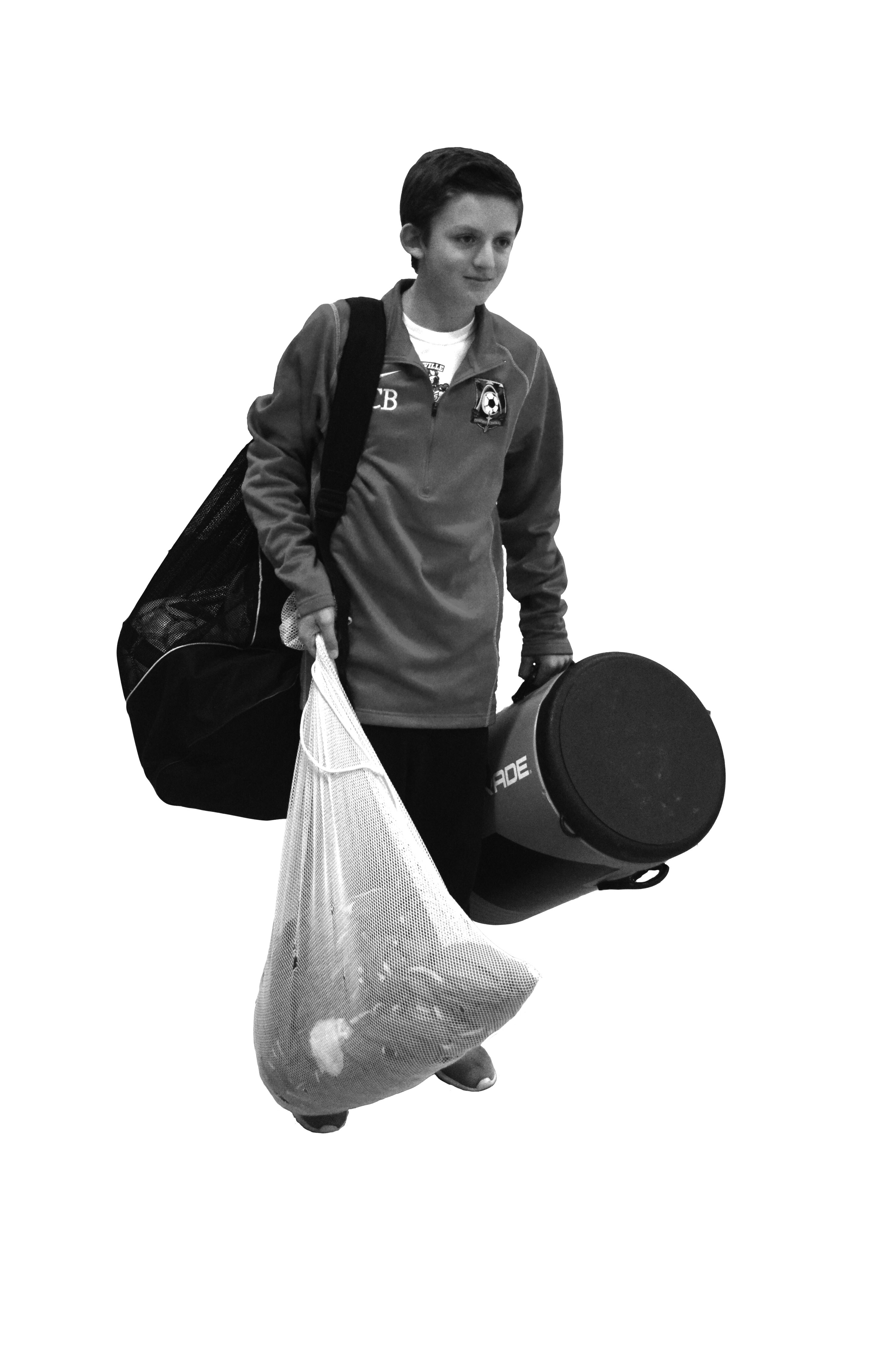 Sometimes freshmen are responsible for carrying much more equipment than the can handle, as illustrated here by freshman Cam Baird. Photo by Dean Trail