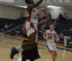 Floating in midair, Jarrett Cox-Bradley makes a layup against Festus in the Ameritime Tournament at Missouri Baptist on Jan. 28 in a 29-point performance. Cox-Bradley averages 30 points a game. Photo by Matthew Gibbs.