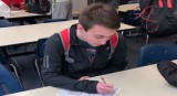 """Senior Nick Austin fills out his FAFSA form. """"The process is pretty tedious. It s a lot better when you can just use the Common Application for several schools, but some schools still don't take it. It's annoying to spend hours putting the dame information to each school individually,"""" said Lucchesi."""