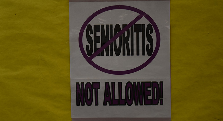 "This sign in math teacher Joslyn Harris's classroom shows that teachers are well aware of senioritis and the impact it can have on student's behavior. ""I've noticed an astronomical increase with tardies. [Seniors] don't sense the urgency to be in class,"" said Bell."
